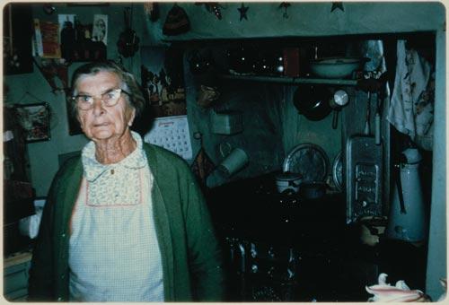 Bell McElligott in her kitchen, 1969