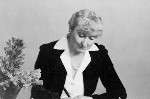 Nelle Scanlan at her desk