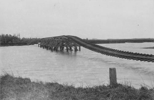 Flood-damaged bridge, Clive, 1897