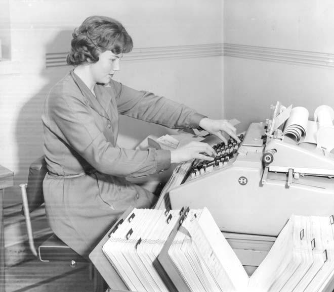 Ledger machine and operator, 1962