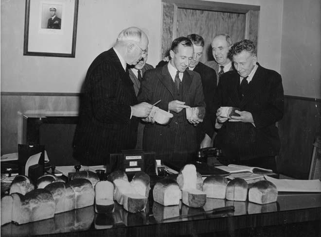 Peter Fraser inspecting loaves