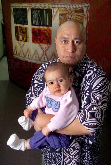 Mua Strickson-Pua and his granddaughter